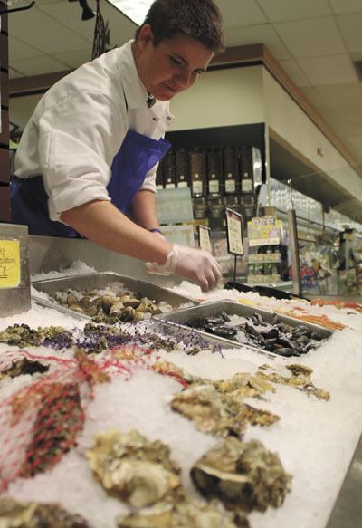 Michael Pedrin works the fish counter at Vashon Thriftway