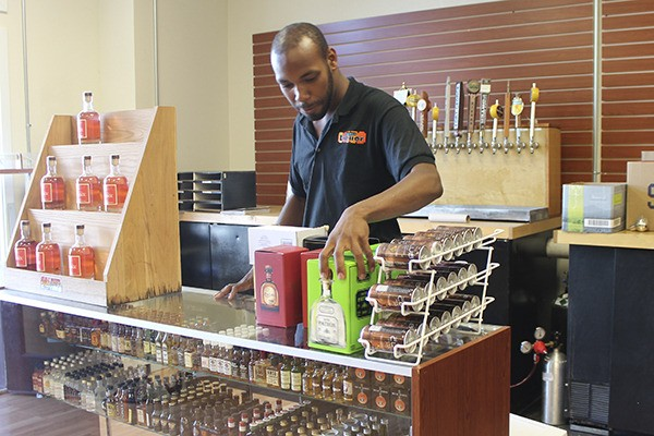 Vashon Liquor employee Cortez Ellison works at the store